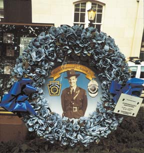 Commission representatives placed this wreath at the memorial's inscription of Officer Schroll's name. photo-Commission Presiden
